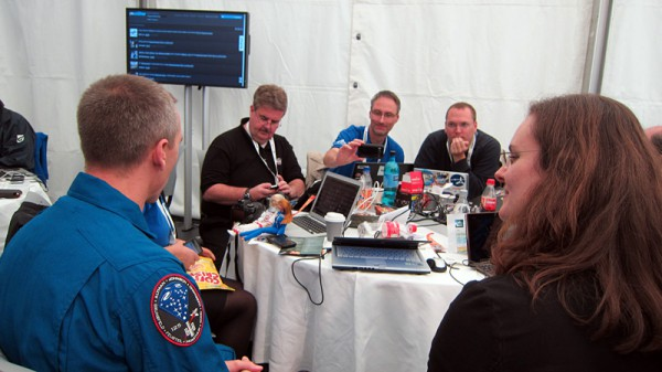 Astronaut Drew Feustel among a spacetweetup table