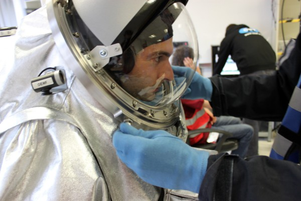 Helmet closure for analog astronaut Joao Lousada during a training session