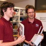 ÖWF/PolAres Freiwillige S. Sams & C. Ragonig freuen sich über die neue Hardware. (c) ÖWF (Daniela Humml)