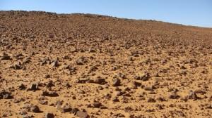 Basalt landscape on desert sand