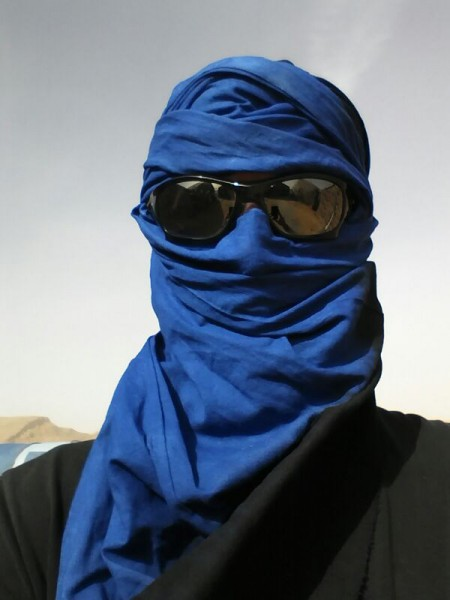 Analog astronaut Luca Foresta wearing a Berber headdress as protection from the sandstorms. (c) OeWF