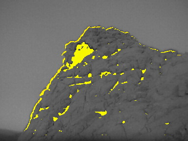 Skyhole cave imaged by IR camera. Yellow areas represent temperatures above 10° C. Note that the cave is warmer than the surrounding cliff surface. (c) OeWF