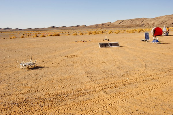 Group picture of MARS2013 experiments: From left: PULI Rover, MEDIAN, Peniculus (front)/MAGMA White (Rear), Hunveyor, and deployable shelter. (c) OeWF (Katja Zanella-Kux)