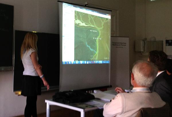 Csilla Orgel discussing maps