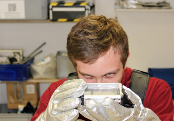 Benedikt Stingl using Aouda.X spacesuit gloves for a practical session