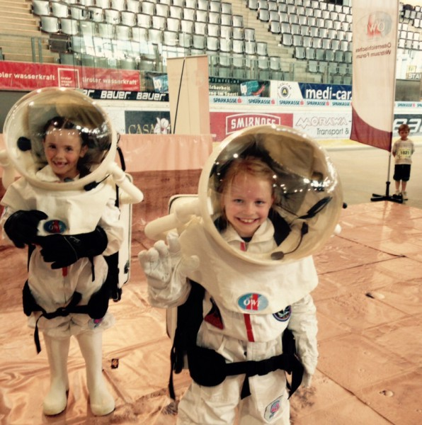 Children astronaut walking on Mars