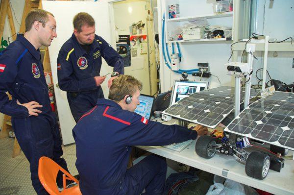 "N. Frischauf (sitting) repairing the ""Sisi"" rover (c) OeWF (Andreas Köhler)"