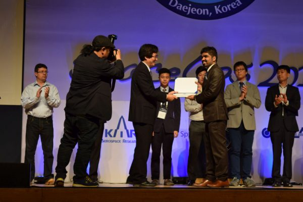 Pradyumna receiving the KARI student scholarship for outstanding academic performance during the SpaceOps conference (c) Mauricio Coen