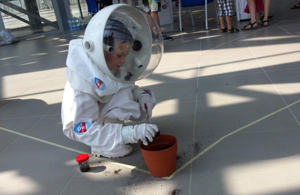 A young astronaut taking a soil sample (c) OeWF