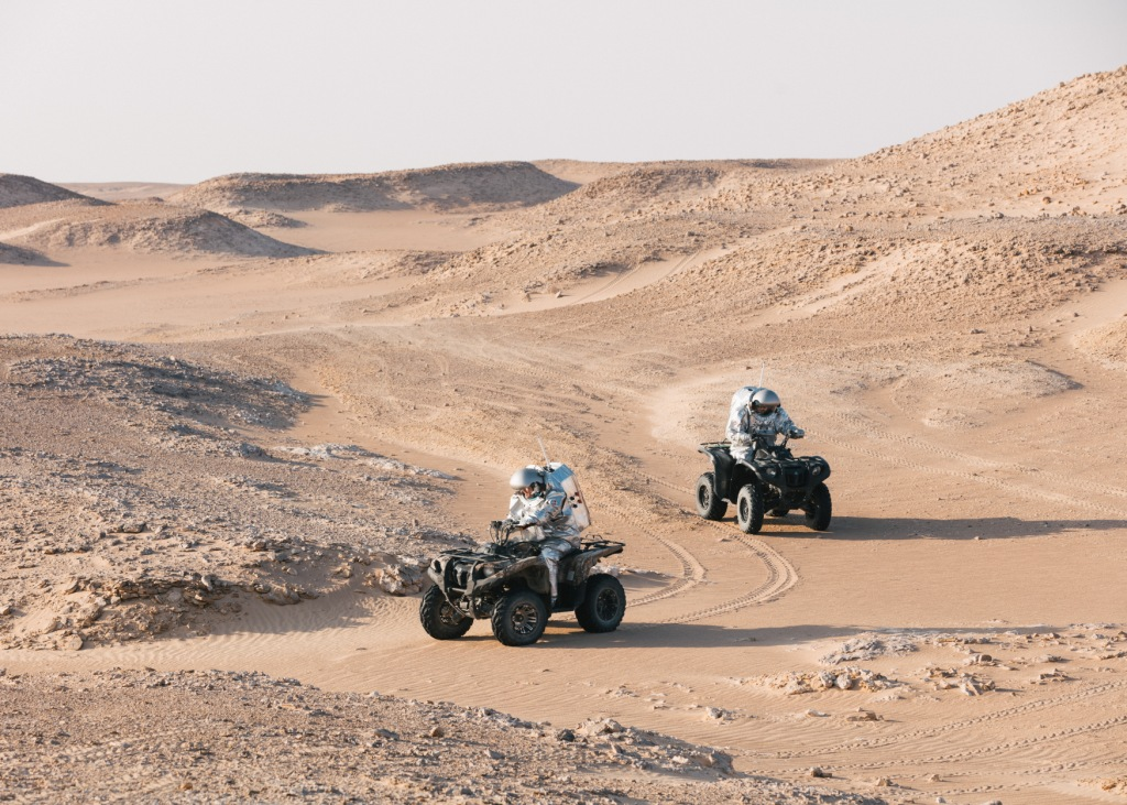 Analog astronauts on quads in the hilly, Mars-like terrain of the Dhofar desert. Photo: (c) OeWF (Florian Voggeneder).