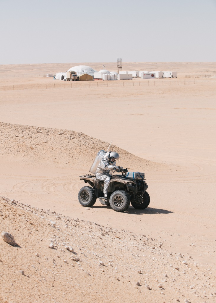 "An Analog Astronaut rides a quad in the Oman desert, in front of the newly named ""Kepler Station"". (c) ÖWF (Florian Voggeneder)."