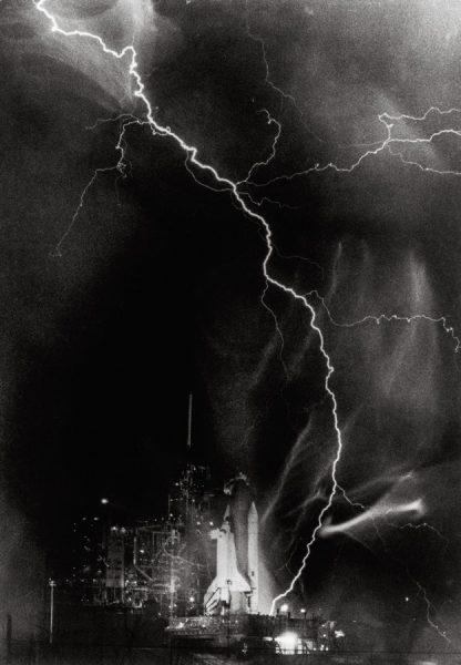 LightningstrikesthelaunchpadofSpaceShuttleChallengerpriortoSTS-8 onAugust30,1983. (c) NASA