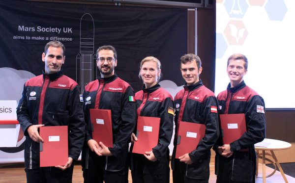Five of the eight new analog astronauts at graduation ceremony in London, from the left: Liad Yosef Israel), Simone Paternostro (Italy), Anika Mehlis (Germany), Robert Wild (Austria), Adam Crellin (United Kingdom), (c) OeWF