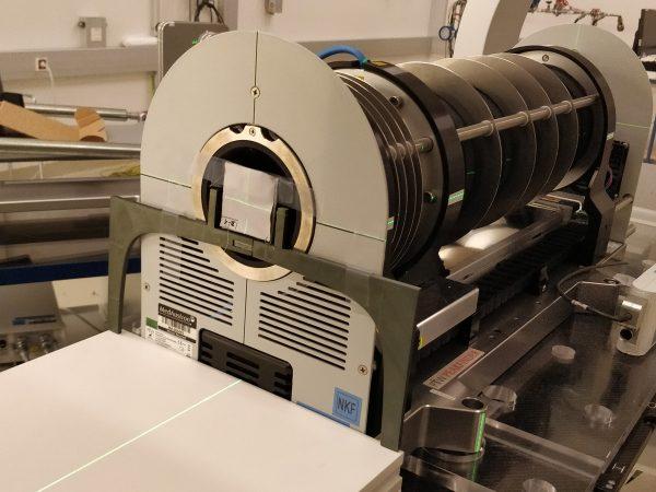 Textile sample in front of the peak finder device at MedAustron (c)  MedAustron, Klampfer