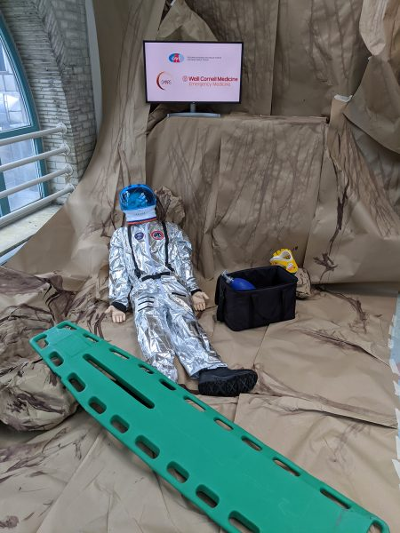 simulation setting with dummy analog astronaut and medical equipment